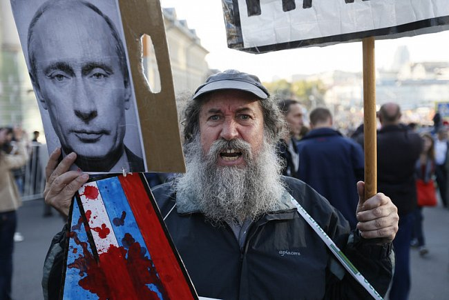 cd61e930303eedfee8c45ec4fa3839a1 Марш мира в России: многолюдно и с украинскими флагами (фоторепортаж)
