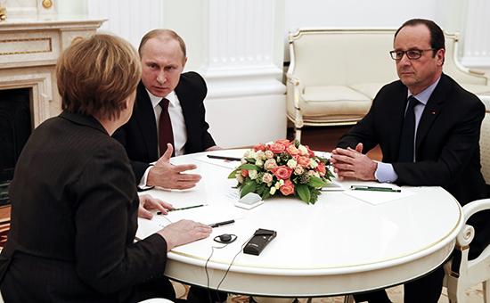 Reuters: Олланд, Меркель и Путин встретились без рукопожатий